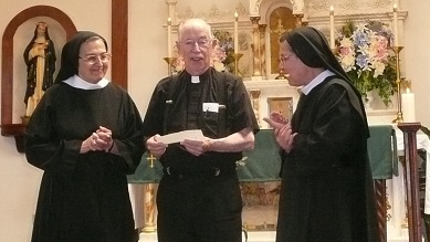 Sister Kateri and Mother Benedicta presenting a check for the new building of the St. Rose of Lima Parish Hall, to Father Jim Walker, Pastor, after Mass on Father's Day, June 19, 2016.