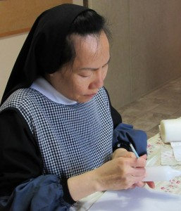 Sister Agnes Le enjoys the craft of painting candles, <a href=